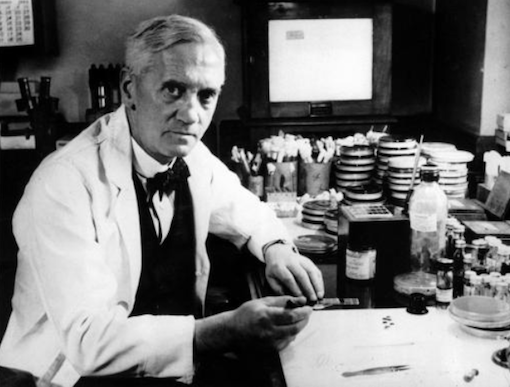 Alexander Fleming at his cluttered laboratory bench.